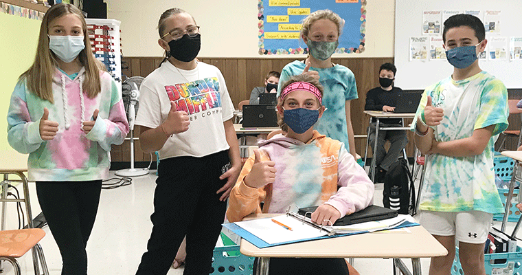 Students wearing tie dyes