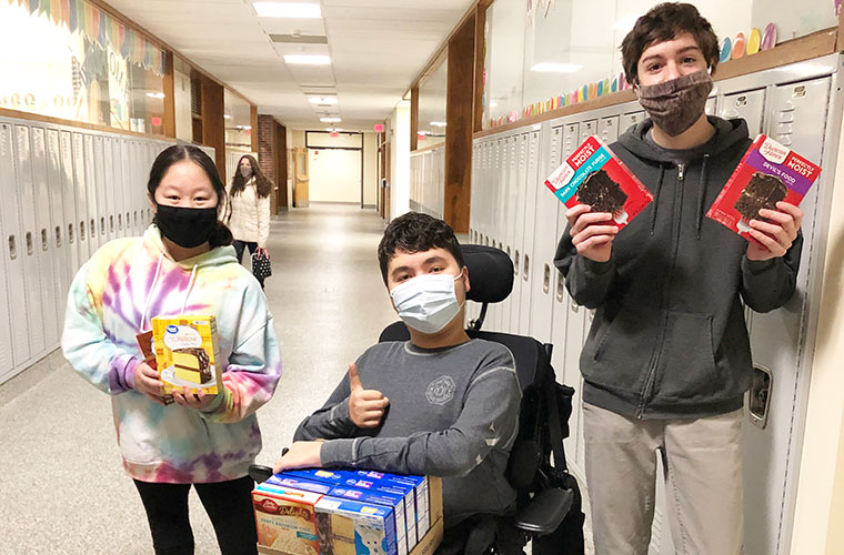 Students with cake mix donations