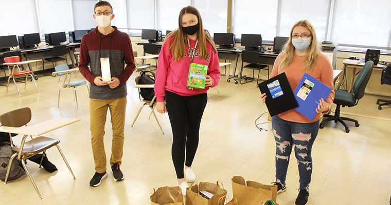Students with school supply donations