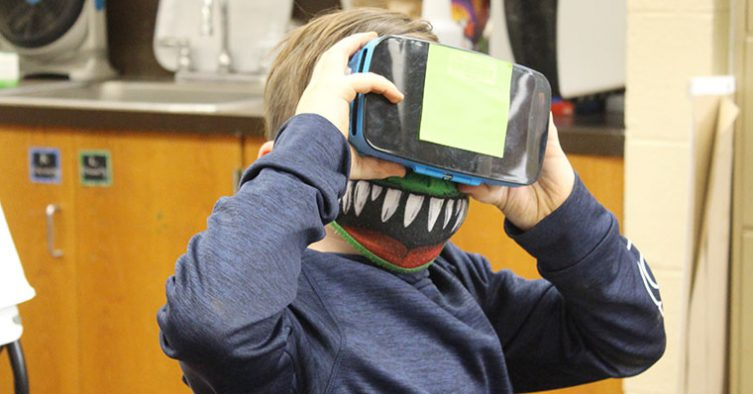 Students use virtual reality goggles