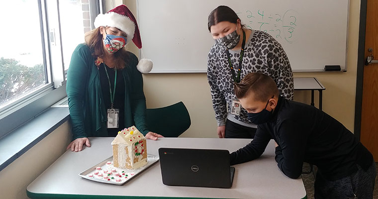 Students with gingerbread house math project