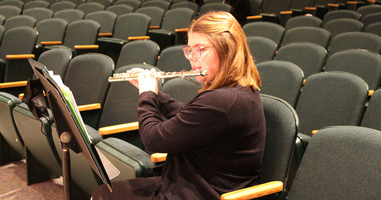 Student plays flute