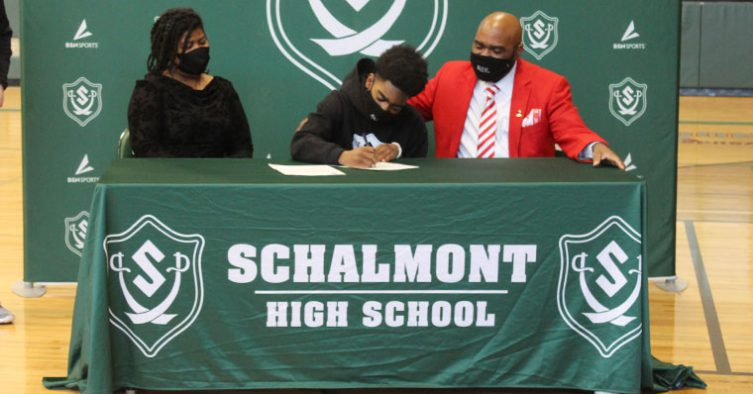 Student signs letter of intent with family