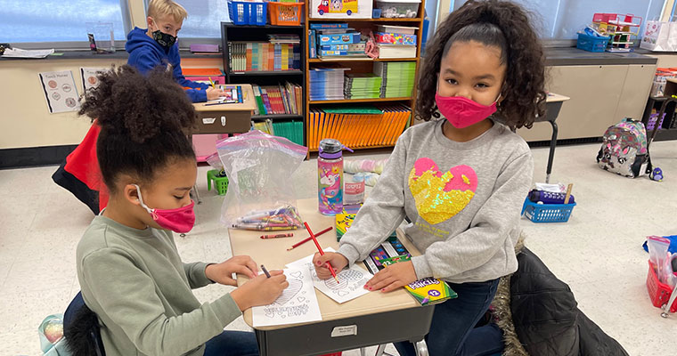 Students making valentines for veterans