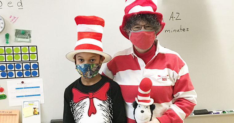 Student and teacher dressed up for Dr. Seuss Day