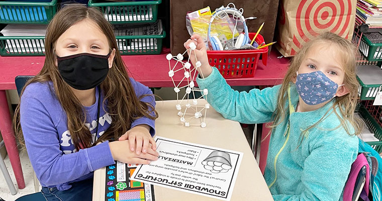 Students work on marshmallow tower