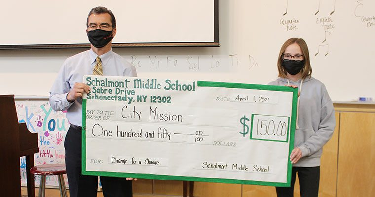 Students presents check to City Mission