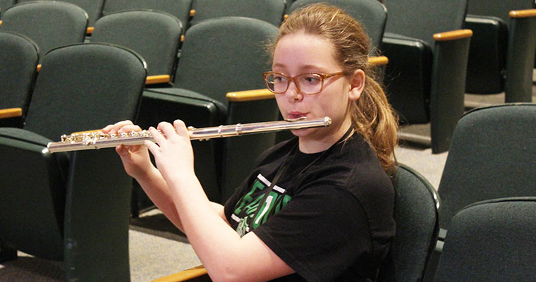 Students plays flute