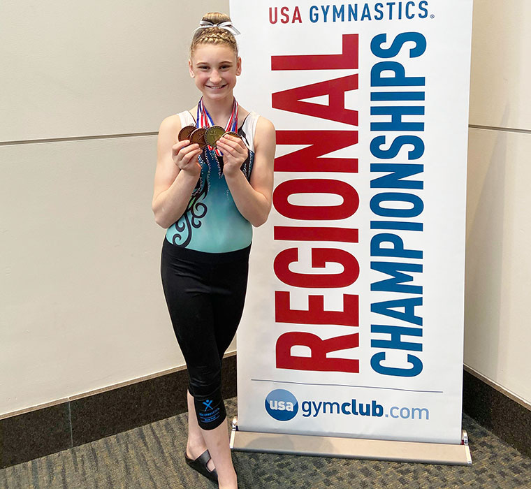 Student with gymnastics medals