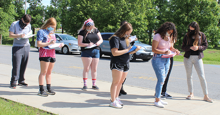 Students outside taking notes