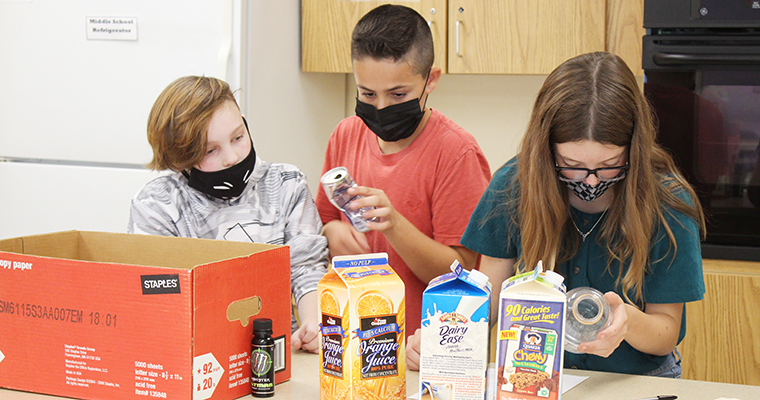 Students read food labels in classroom